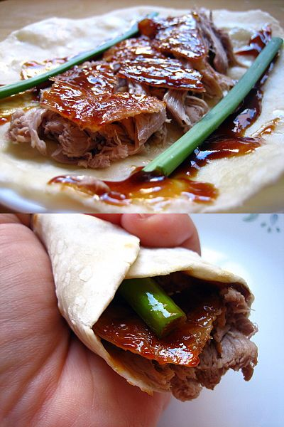 Roll the duck and the condiments into the pancake and eat by hand.