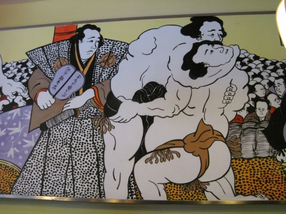 The restaurant is decorated with a mural of Japanese men carrying out some ritual that I cannot identify, nor am I sure I want to.