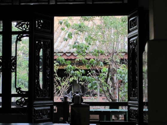 Looking through the ancient window at the trees waving in the balmy breeze, I could almost believe I was in Rangoon.