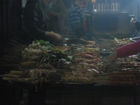 Most Chinese street food vendors, like this Muslim barbecue seller, use safe, healthy oil.